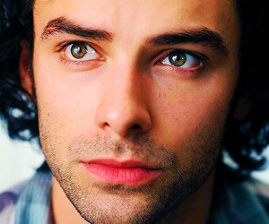 aidan turner and puppy image