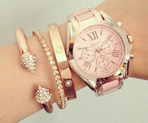 chic, rose gold, and cartier love bracelet image