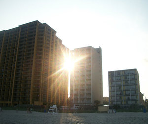 beach, hotel, and sand image