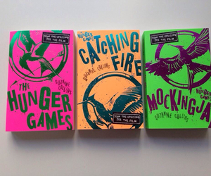 mockingjay, catching fire, and book image