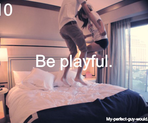 playful, guy, and bed image