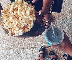 girl, popcorn, and friends image