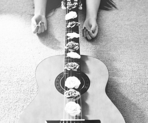 guitar, flowers, and black and white image