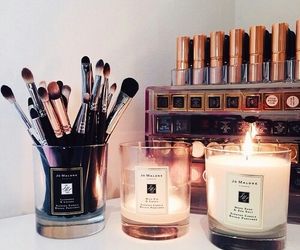 Brushes, makeup, and candles image