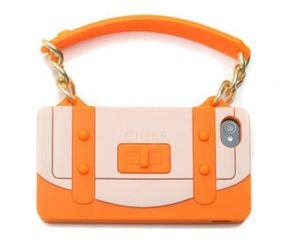 cell phone, purse, and orange image