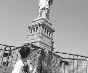 couple, new york, and statue of liberty image