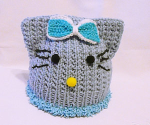 blue hat, cat, and hat image