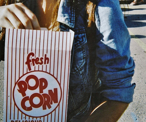 girl and popcorn image
