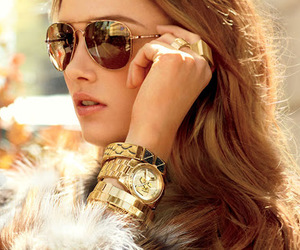sunglasses, watch, and model image