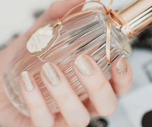 nails, perfume, and gold image