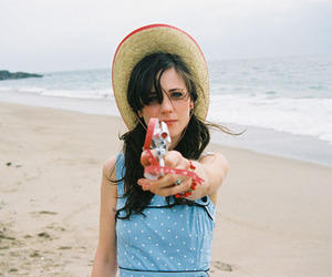 zooey deschanel, beach, and gun image
