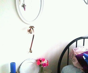 candle, flowers, and mirror image