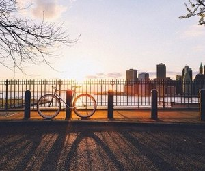 city, bicycle, and sky image