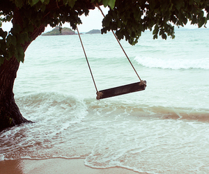 sea, swing, and tree image