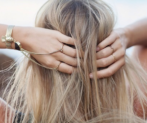 blond hair and bracelet image