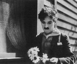 black and white, charlie chaplin, and flowers image