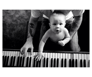 baby and piano image
