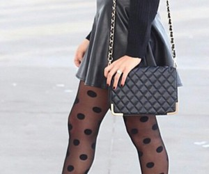 black purse, black sweater, and black booties image