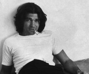 Antonio Banderas, dark hair, and smoking image