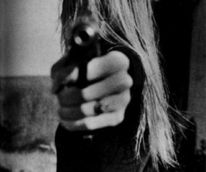 girl and pistol image