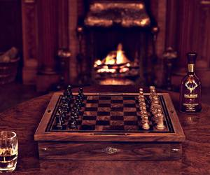 chess, fireplace, and glass image