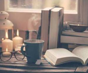 book, candel, and hot tea image