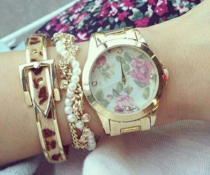 watch, accessories, and flowers image