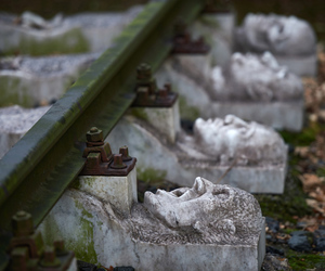 tracks, train, and gargoyles image