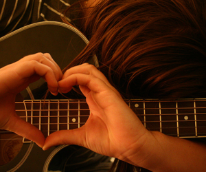 guitar, hands, and heart image