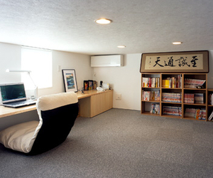 bookshelves, comfy chair, and desk image