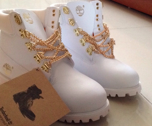 chains, gold, and timberland image