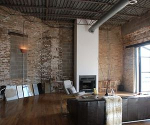 brick wall, couch, and district image