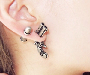 gun, earrings, and piercing image