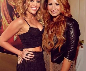 miley cyrus, demi lovato, and miley image