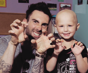 adam levine, maroon 5, and cancer image