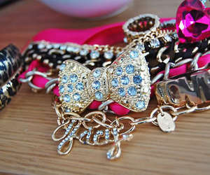 bow, gold, and pink image