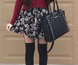 black tights, floral skirt, and gold necklaces image