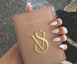 nails, passport, and vs image