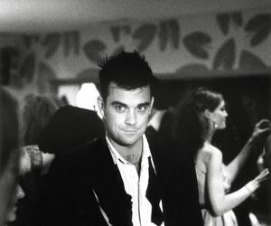 Robbie Williams, video, and come undone image
