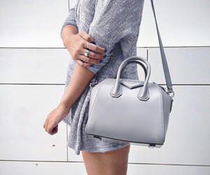 grey sweater, silver rings, and givenchy bag image
