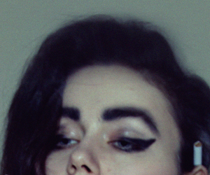 cat eyes, cigarette, and eyebrows image