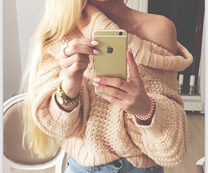 blonde hair, sweater, and bracelets image