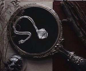 mirror, crystal, and dark image