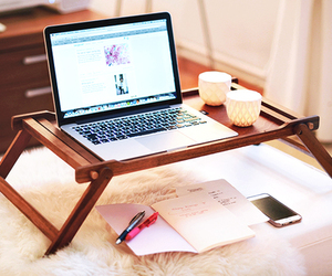 iphone, laptop, and candle image