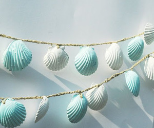 back drop, blue, and shells image