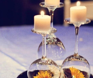 candle, flowers, and glass image