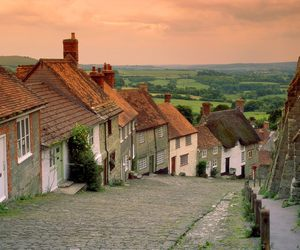 sunset, village, and cobblestone road image
