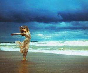 dancing, woman, and on the sand. image
