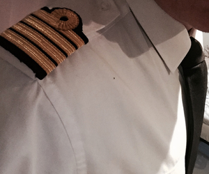 airline, captain, and gold image