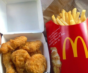 food, fries, and chicken nuggets image
